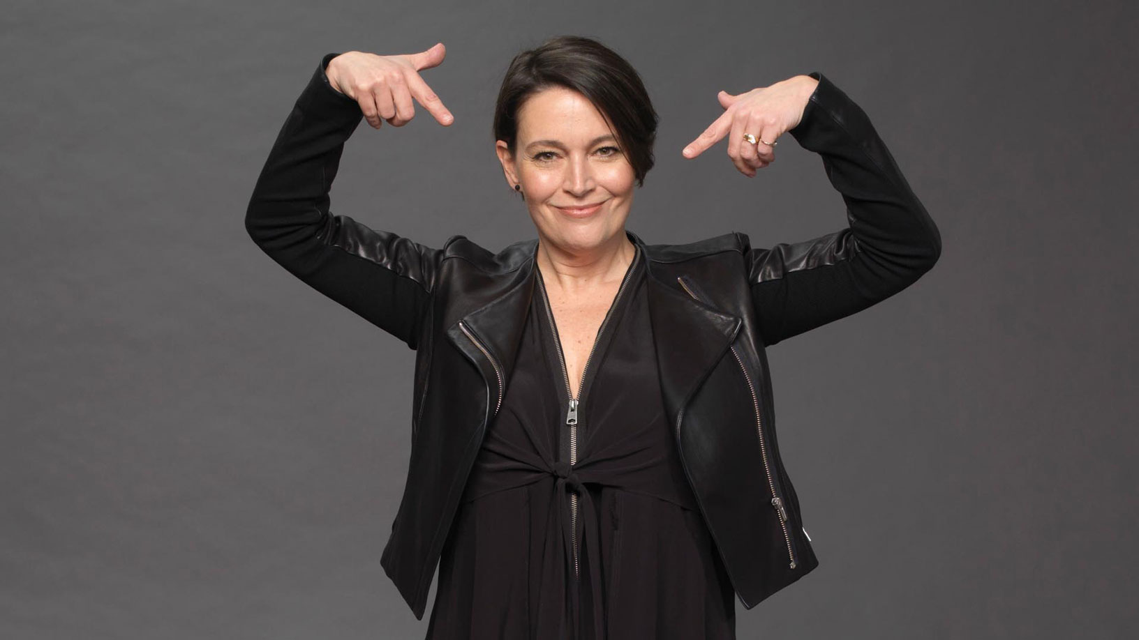 a menopausal model in a black pleather jacket